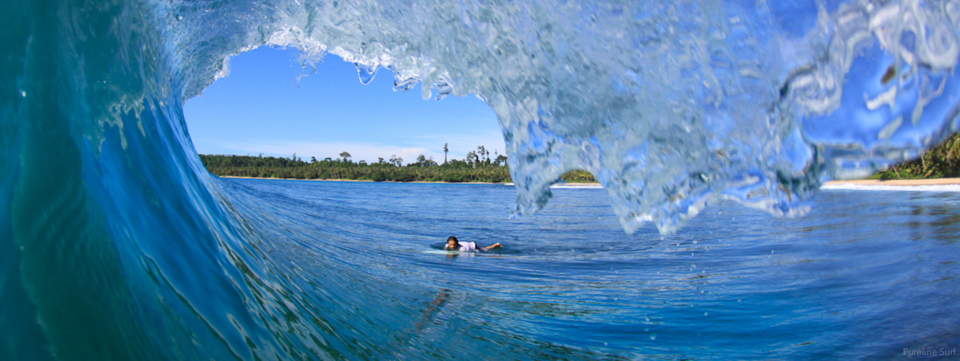 View from the inside of a barrelling wave taken in Indonesia, one of Pureline's worldwide coaching destinations.