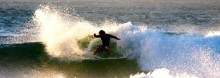 Alex, Pureline Surfs head surf coach throwing some serious spray on a trip to Hawaii.