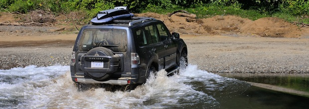 Driving through the Nosara river on the way surfing