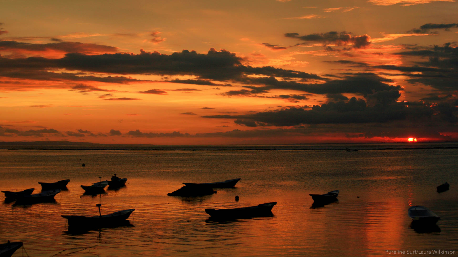 Boats at sunset in Nusa Lembongan, Bali. Another great location we enjoy on our worldwide surf coaching trips with Pureline Surf.