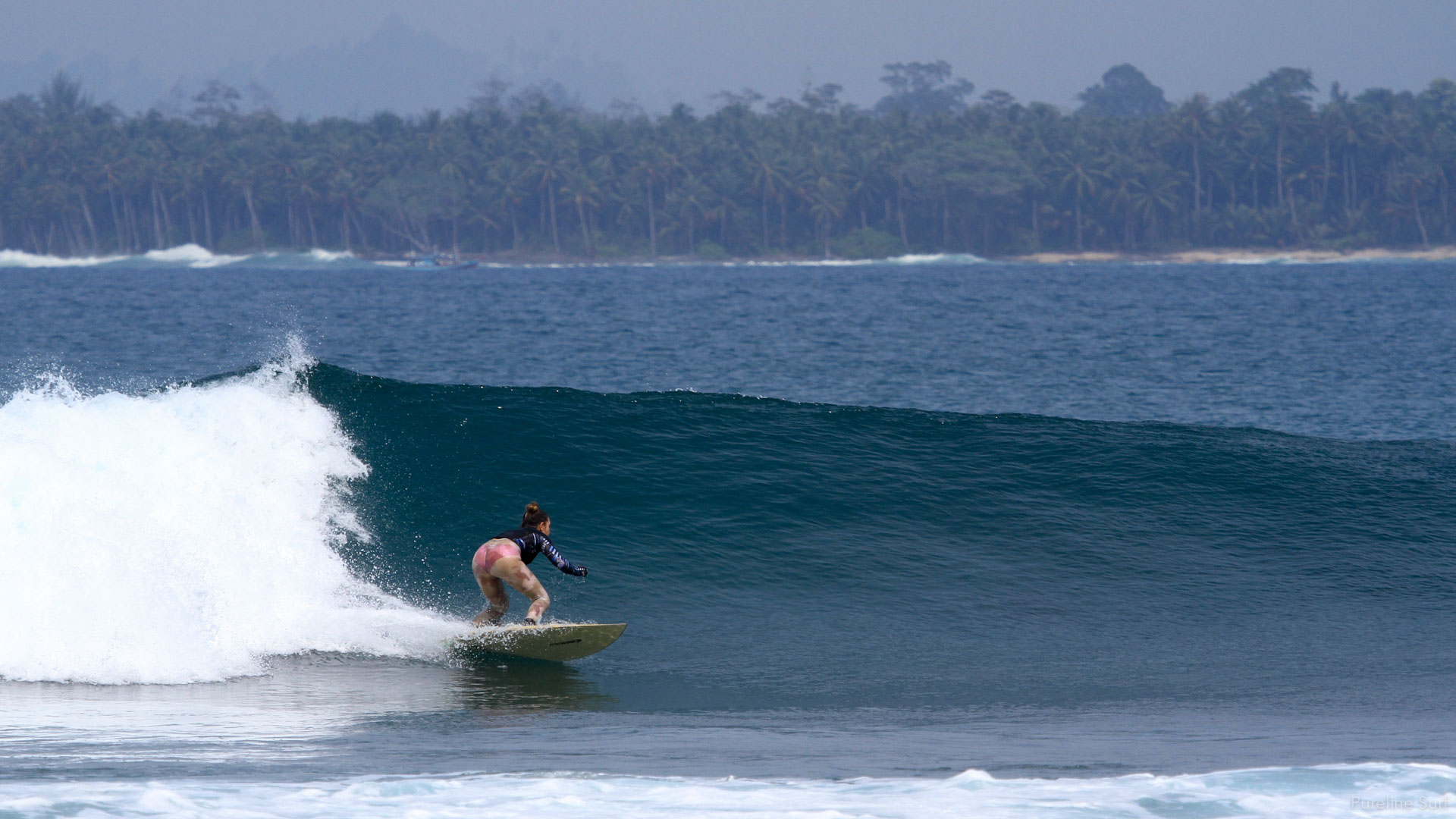 A Pureline Surf Coaching client getting a fun wave at Being Bing's in the Mentawai Islands as part of our worldwide coaching program.