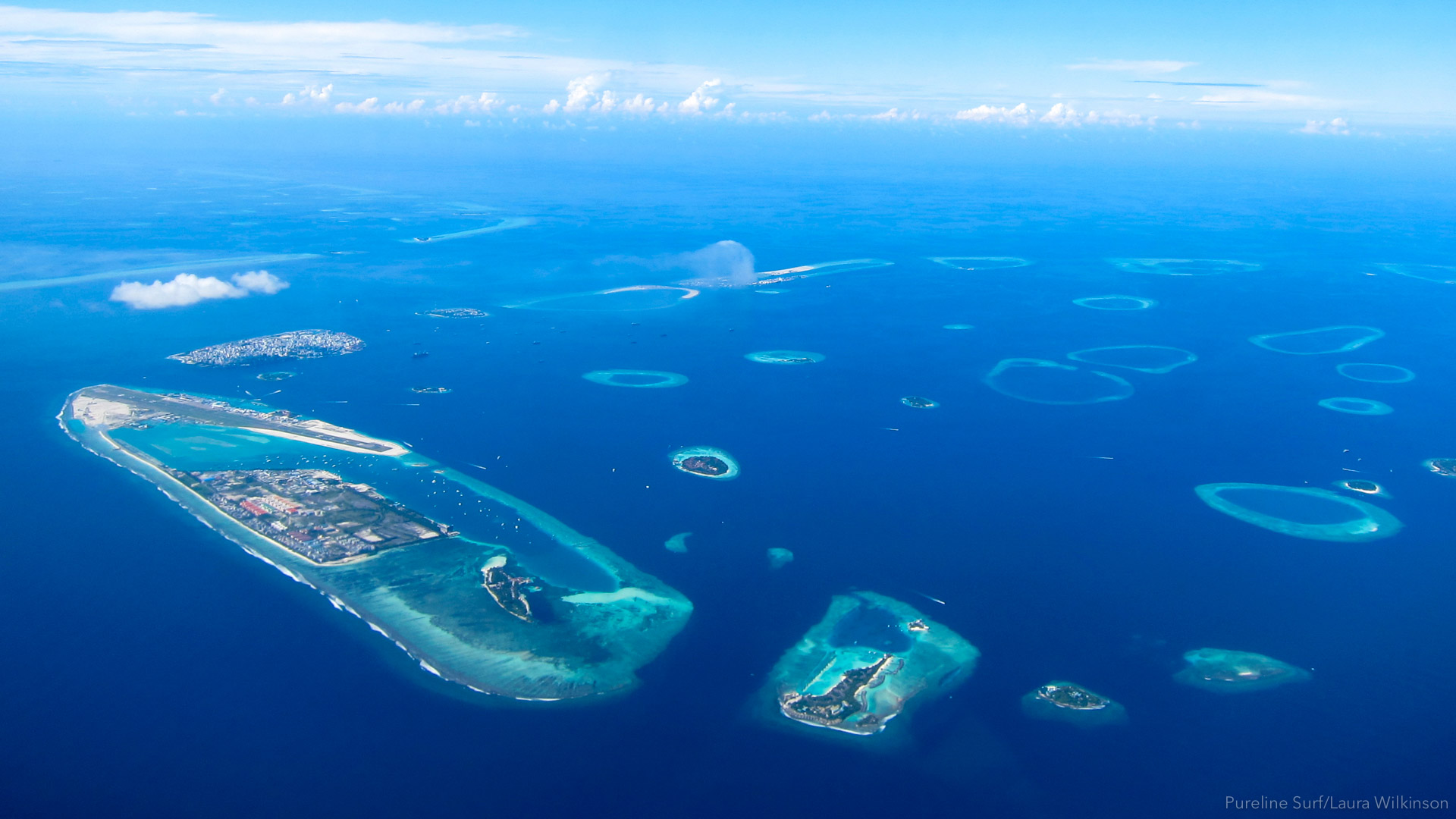 The view of the Maldives from above. The Maldives is a location we love using in our worldwide surf coaching trips with Pureline Surf.