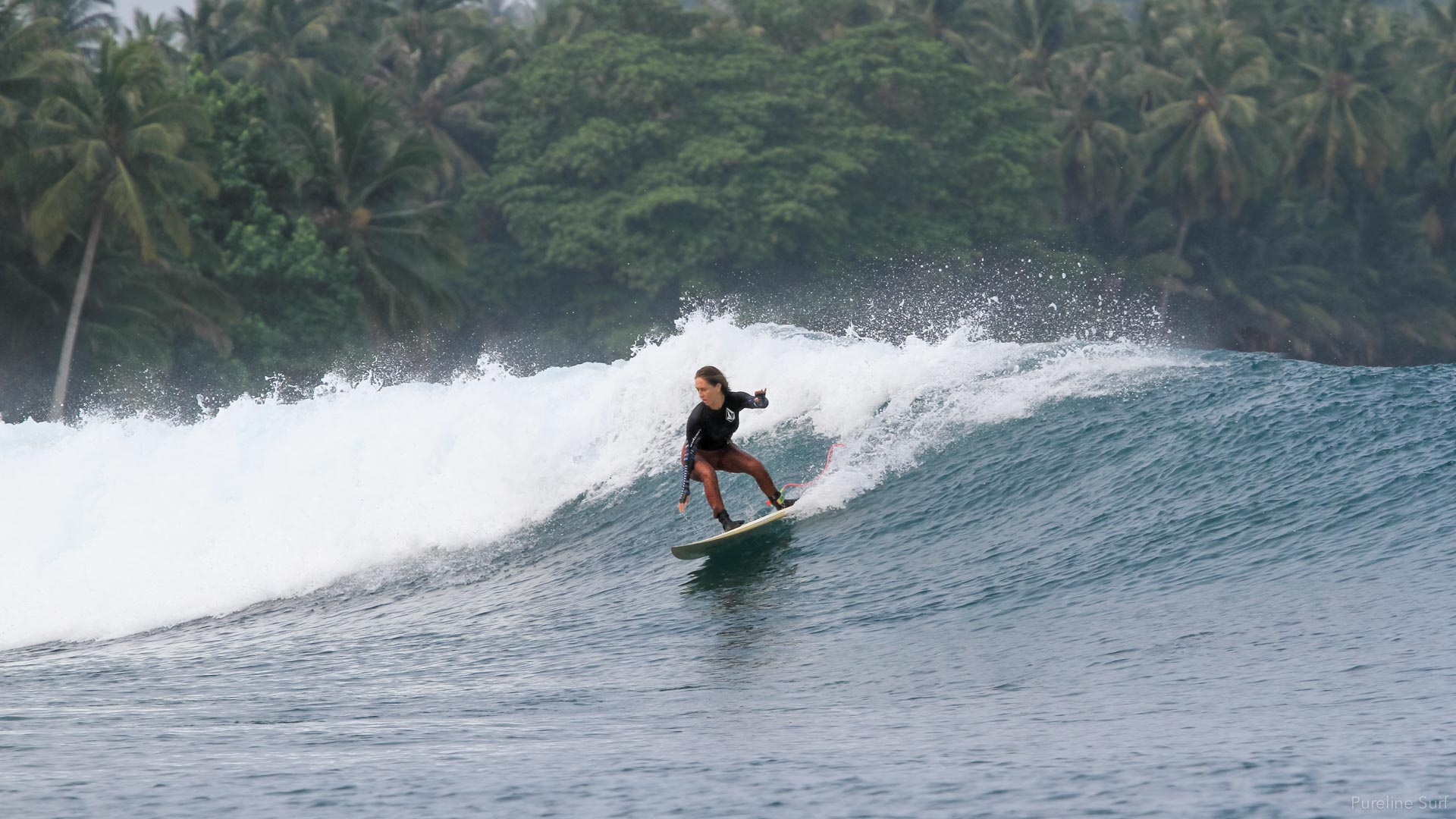 Forehand carve during a private surf coaching and guiding trip to Indonesia with Pureline Surf.