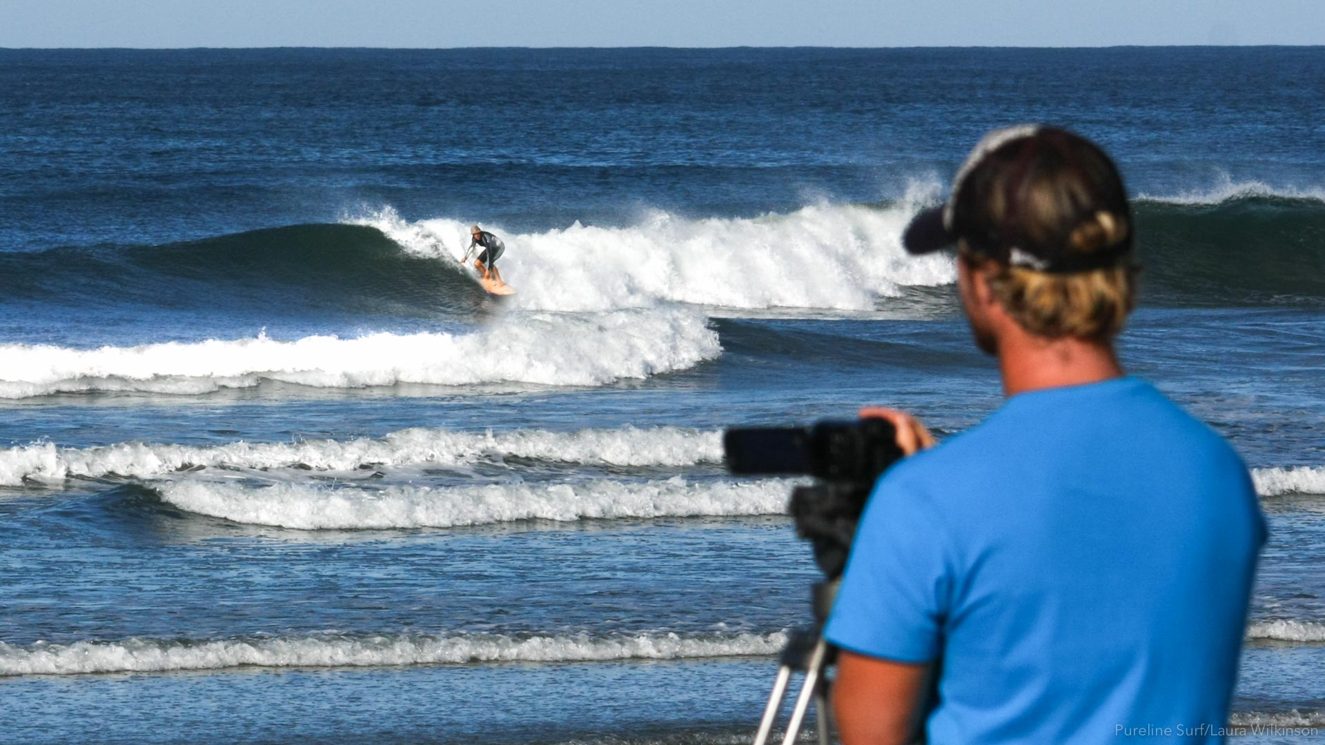Photo of a surfer getting filmed. Video analysis should be part of any surf coaching experience. Pureline Surf