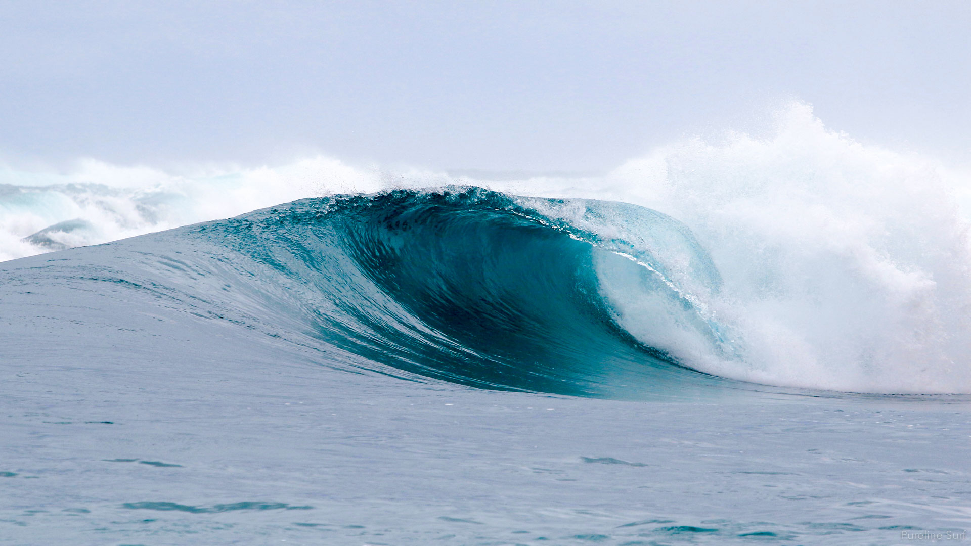 Perfect right in Indonesia. Our coaching style at Pureline Surf aims to give you confidence in bigger surf.